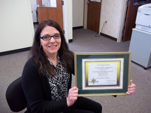 Quality Manager Kristin Zuzek holds up the AAVLD Accreditation Certificate recently awarded to WVDL.